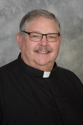 Father Bryan D. Ernest, Pastor